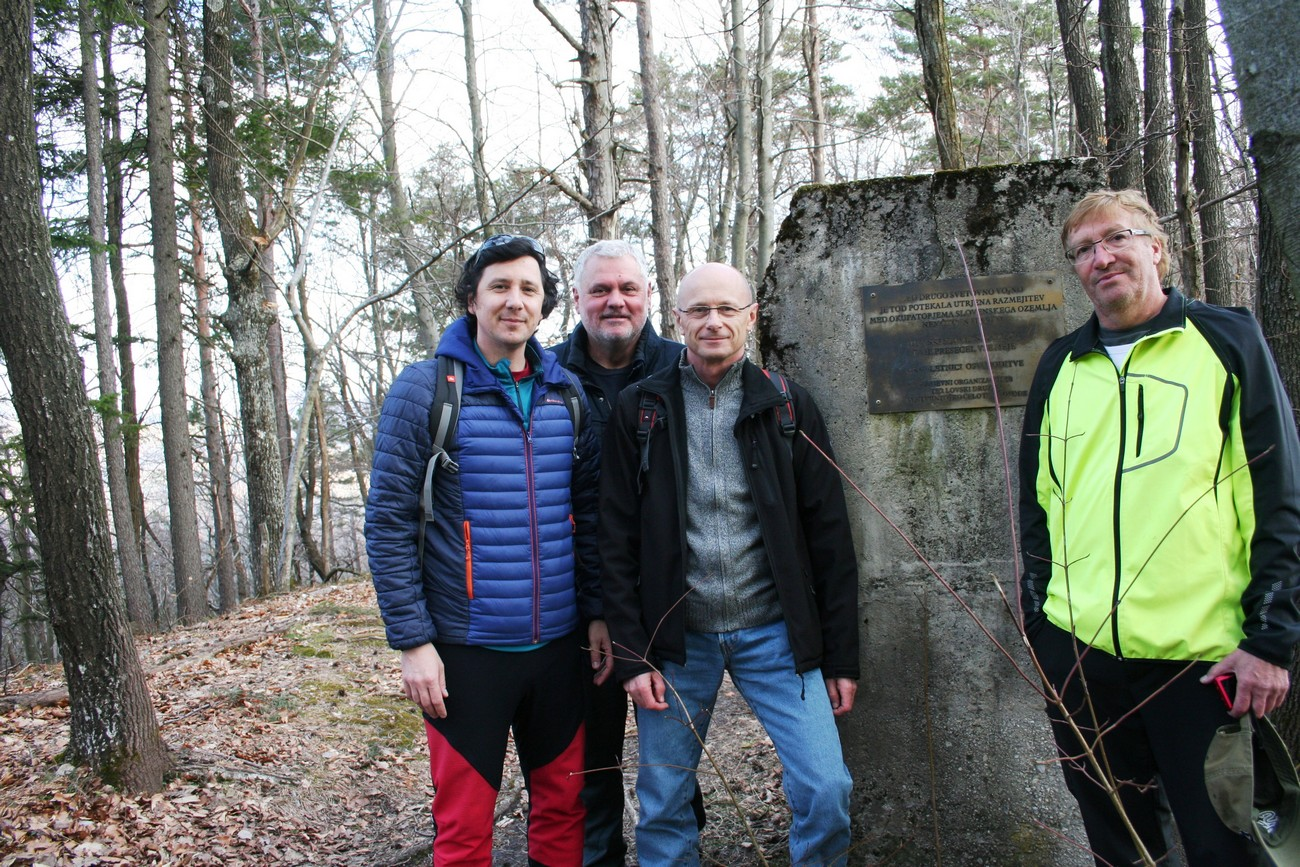Concrete remains of the foundations of German watchtowers on the hill Toško čelo near Ljubljana and a part of the project team (from left) Peter Mikša, Božidar Flajšman, Bojan Balkovec and Božo Repe at the concrete foundation of a watchtower. Author: Božidar Flajšman.