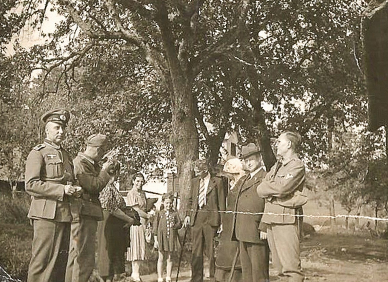 The occupier's units, which were stationed in Rogaška Slatina, often came to the nearby countryside. This photograph was taken in 1942, when three Germans visited Krumpak's shop in Cerovec. Published courtesy of the Krumpak family, who own the original.