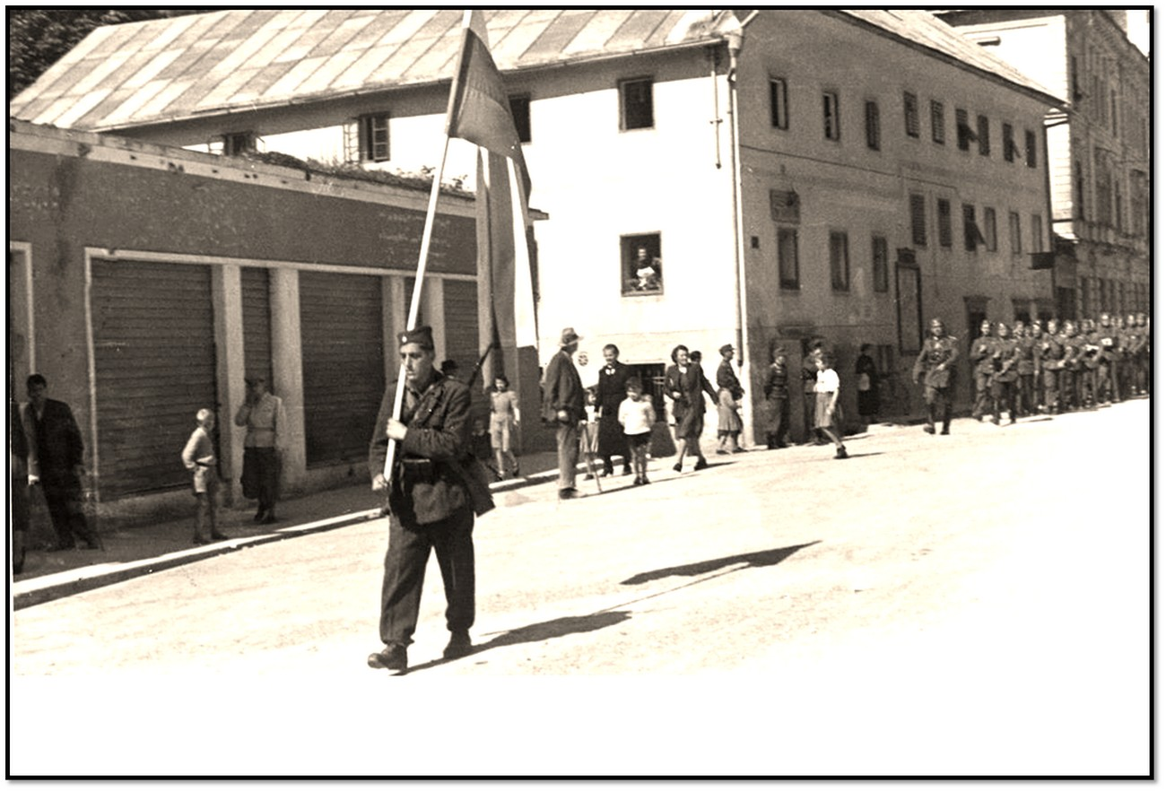 Members of the Slovenian National Defense Corps (Littoral Home Guard) marching through Idrija. The group in Idrija was about 50 strong. Private archive of Slavko Moravec, Idrija War Museum.