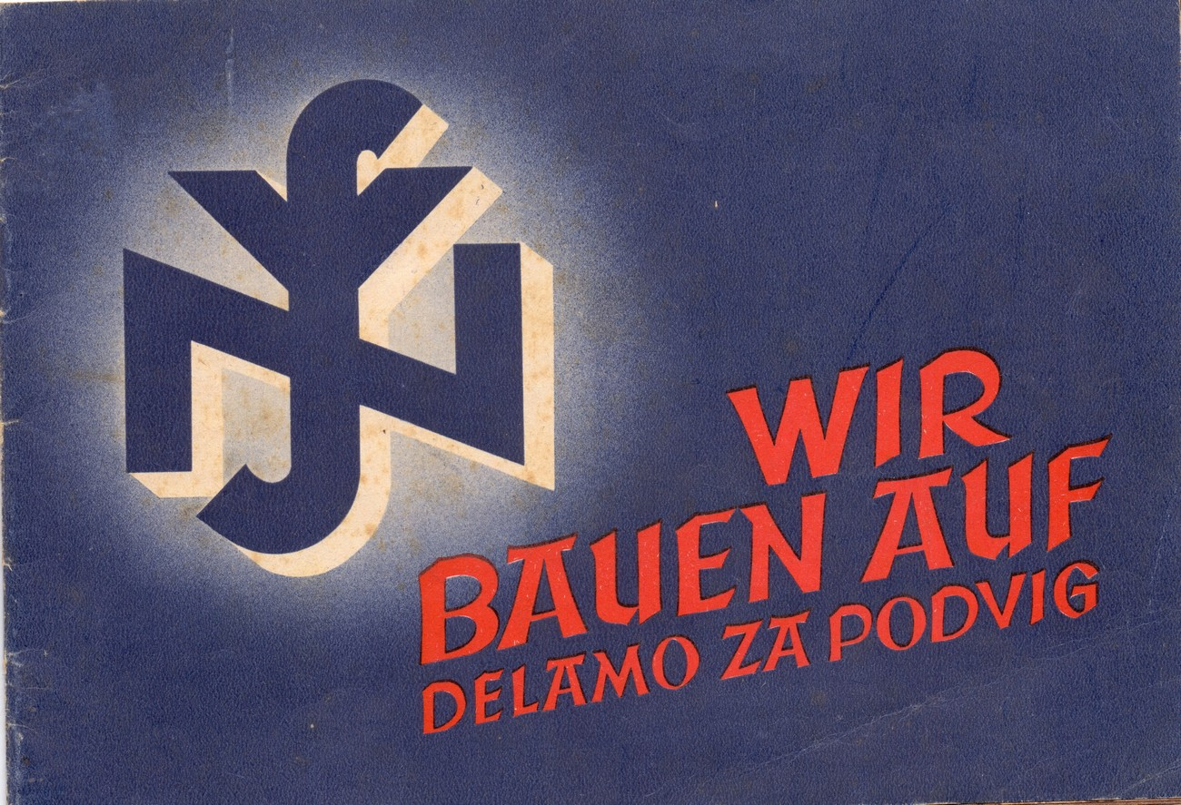 "In the photograph, we can see the first page of the brochure ""Wir bauen auf,"" which had been published by the National Socialist German Workers' Party (NSDAP). The brochure presents the activities of the National Socialist People's Welfare (NSV) that were carried out in Gorenjska: taking care of the helpless and the impoverished, establishing centres for mothers and children and sanatoriums for mothers, taking care of children in kindergartens and youth homes. This was also one of the reasons why some residents of Žiri would prefer to be occupied by Germans instead of Italians. SI ZAL ŠKL, 0268, 41, B-I-4-3-1."