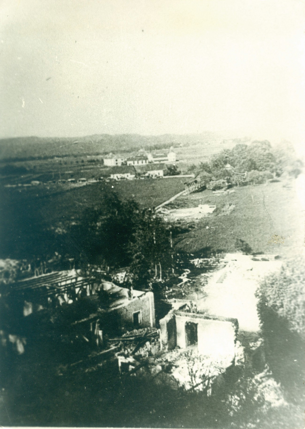 Demolition of the houses on the Italian–German border in Podgora on present-day Cesta Andreja Bitenca. Germans also demolished Zalokar's house below the Italian–German border crossing. The meadows and fields in the background have been developed after the war; today, this is Cesta Andreja Bitenca. In the background is the junction of Cesta Andreja Bitenca and Celovška cesta where the border crossing between Germany and Italy was located. Author: Tine Bitenc. Archive of Milena Zalokar.