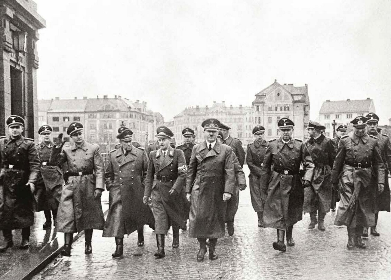 """Adolf Hitler inspecting the demolished bridge over the Drava River in Maribor, 26 April 1941. MNZS. It is incorrectly mentioned in literature that Hitler uttered the famous sentence """"Make this country German again!"""" in his speech given on the balcony of the town hall in Maribor on 26 April 1941. In reality – according to the speech given by the Chief of the Civil Administration of Styria dr. Uiberreither on 28 April 1941, likewise on the balcony of the town hall in Maribor – he had given that order earlier. In his speech Uiberreither said that Hitler had addressed him with those words when handing over the administration three weeks earlier. Source: Repe, S puško in knjigo, 24."""