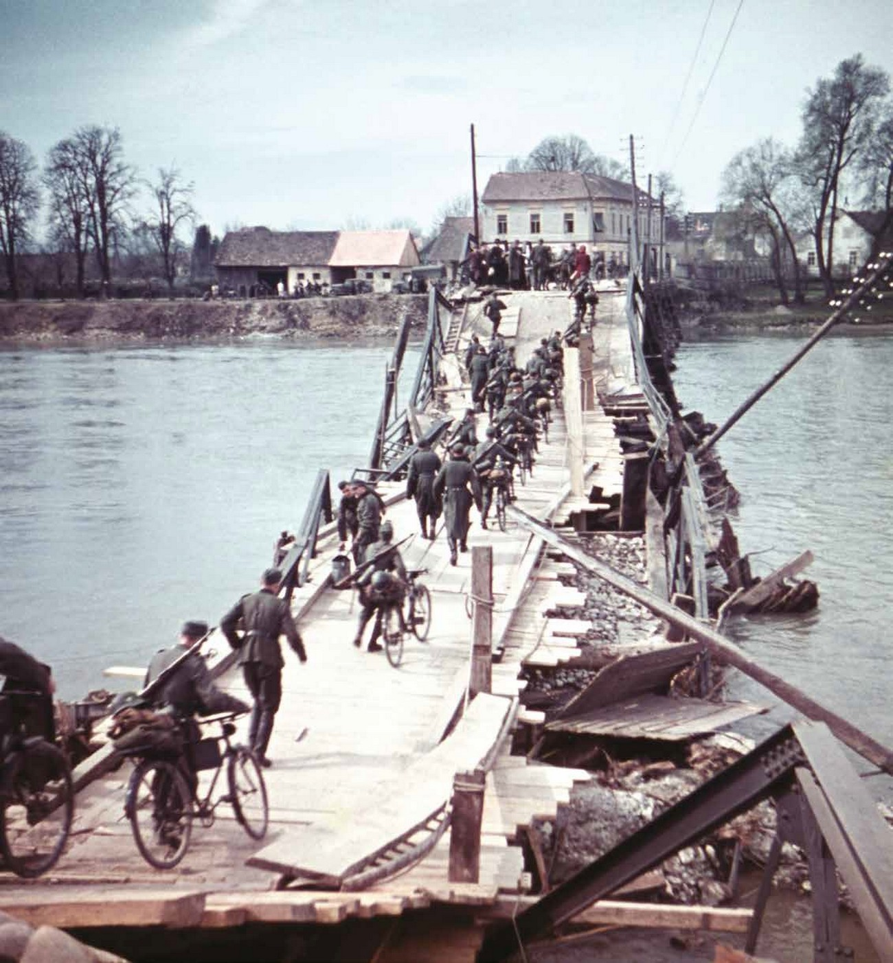 German Army crossing the Drava River across a demolished bridge, Ptuj, 1941. MNZS.